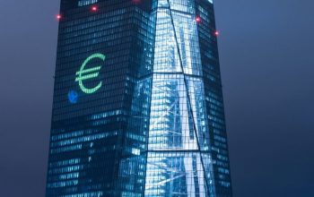 BRX514. Frankfurt/main (Germany), 12/03/2016.- A photograph made available on 13 March 2016 showing a Euro symbol projected onto the European Central Bank (ECB) in Frankfurt am Main, Germany 12 March 2016. The European Central Bank (ECB) is participating in Luminale, a light show that takes place every two years in Frankfurt. Both the ECBís main building by the river Main and the Eurotower in the city centre will be illuminated by a ìsymphonyî of light consisting of bars, lines and circles ñ primarily in blue and yellow, the colours of the European Union. It will be based on Ludwig van Beethovenís Prelude to the Ode to Joy, the European anthem. The euro symbol will be projected onto the south facade of the main building and will be visible to passenger planes on approach to land at Frankfurt airport. The light show takes place every day from 20:00 CET to midnight from 13 to 18 March 2016. (Alemania) EFE/EPA/BORIS ROESSLER 4651#Agencia EFE