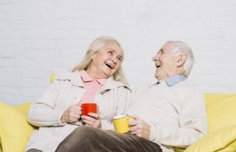 senior-couple-with-mugs-coffee_23-2148014527