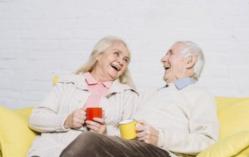 senior-couple-with-mugs-coffee_23-2148014527